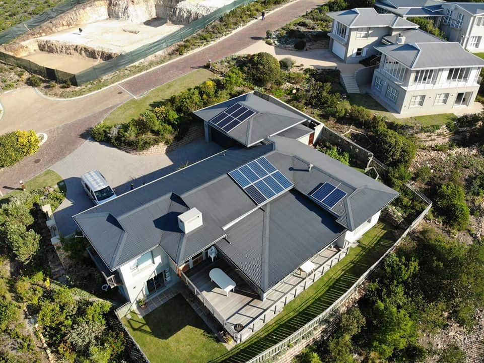 Home with Solar on Roof aerial photo - Image by Blue Planet Power